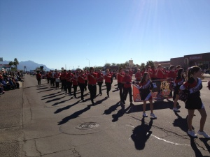 CCJH cheerleaders and band members march in the Lost Dutchman parade on Feb. 23.