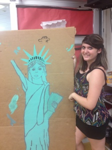 StuCo representative Diana Elliott poses with a Statue of Liberty that will be used as decoration for this year's welcome back dance.
