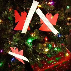 Tags hang on the Angel Tree, waiting for someone to pick them up and purchase the gift.