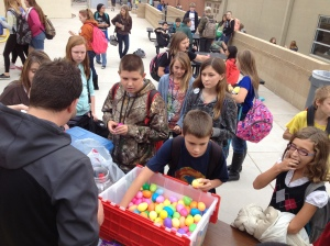 Students play the egg game during lunch. Money raised from the game went to purchase gifts for the Angel Tree program.