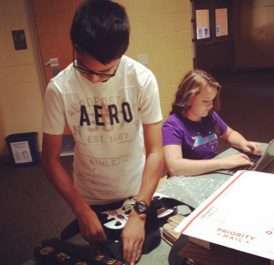 Students prepare items for shipping after selling them on eBay as part of Mrs. Anderson's project.
