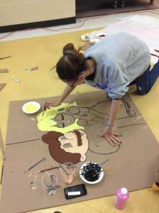 StuCo Vice President Angel Meeks paints Mario and Peach to decorate the Loving Legends Valentine's dance on Feb. 12.