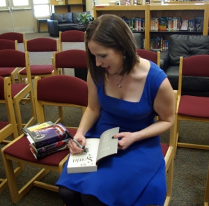 Author Marissa Meyer signs autographs during her visit to CCJH. (Photo by Rose Hansing)