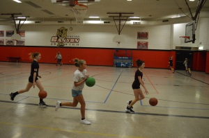 Girls basketball players prepare for the new season. (Photo by Brooke Wine)