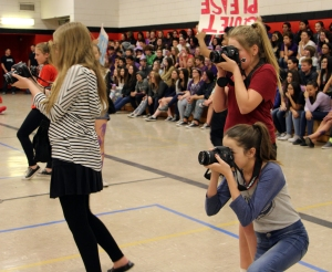 Yearbook students use new cameras to take photos during a spirit assembly. (Photo by Mr. Davis)