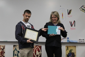 Yearbook adviser Mr. Davis is presented with an award from Lifetouch representative Julie Bales. (Photo by Jaden Miner)