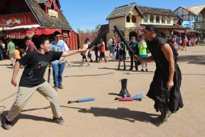 Life Skills students participate in a mock sword fight during a trip to the Renaissance Festival on March 3. (Photo by Mr. Davis)