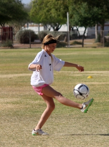 Jaden kicks a ball during practice. (Photo by Robin Marshall)