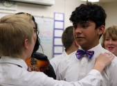 Eighth grader Kyle Caillouette calms a nervous Jose Ayala before the fall music concert. (This photo earned an Honorable Mention for photographer Brooke Wine.)