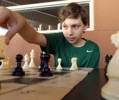Seventh grader Weston Workman moves his knight during a chess club practice match in March. Cactus Canyon was preparing for a tournament against the club from Apache Junction High School. (This photo earned a Superior rating for photographer Justin LaPrise.)