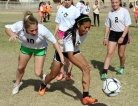 Seventh grader SeAnna Brennan and eighth grader Kaira Landa chase the ball during a keep-away drill. The drill helps players complete multiple passes consecutively and improve their with teammates. (This photo earned an Excellent rating for photographer Brooke Wine.)