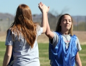 Eighth grader Addison Geiger, right, high fives eighth grader Emily Reynolds during a PE soccer game. Reynolds had just scored a goal with an assist from Geiger. (This photo earned an Excellent rating for photographer Megan Wagner)