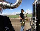 """Eighth grader Josh Natividad practices his baritone saxaphone in the school parking lot on Nov. 5. The marching band was practicing the """"CCJH"""" cadance and other songs in preparation for the Apache Junction Veteran's Day parade. (This photo earned an Excellent rating for photographer Skylar Sosa.)"""