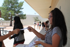 Eighth grade StuCo representative Ruby Verduzco sells a ticket to the dance. (Photo by Chloe Krueger)