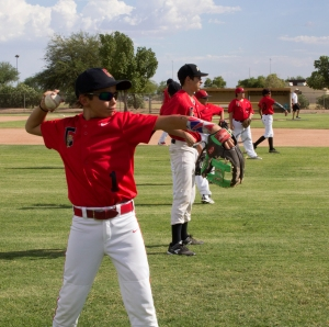 Members of the baseball team warm up before their home game against Maricopa Wells on Aug. 30. (Photo by Jaden Miner)