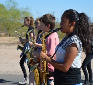 Members of the marching band practice outside in preparation for their trip to Arizona State University. The group played on the field at halftime of the ASU football game on Oct. 8. (Photo by Brooke Wine)