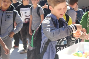 Seth Wright plays the egg game during lunch. The game, along with NJHS coin drive raise money to help CCJH donate turkey dinners and Christmas gifts. (Photo by Hannah Molino)