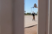 In a friendly game of basketball at lunch, eighth grader Alex Armendariz, 8, shoots hoops with some of his friends. (Photo by Chloe Krueger)