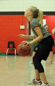 Eight grader Kaylee Smith dribbles during a basketball camp in September. The girls basketball team hopes to defend its league title  when the new season begins in January.