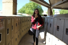 When coming back from lunch, Tori Boudreau, 8, eats an apple while walking to class. (Photo by Maddy Parker)